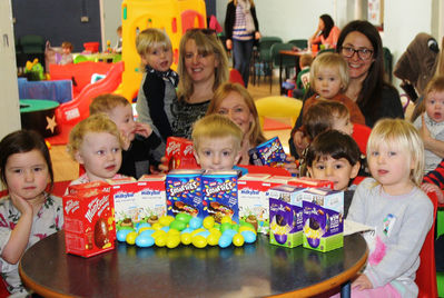 Children and parents at Portishead's youth and community centre, with Easter Eggs donated by Reeds Rains