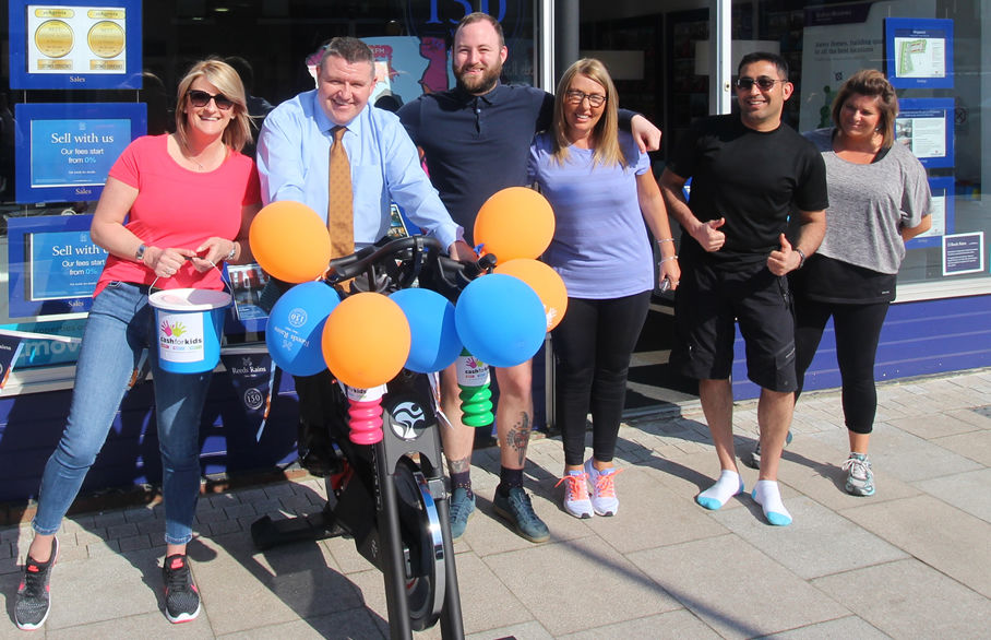 Superheroes bikeathon for Cash for Kids