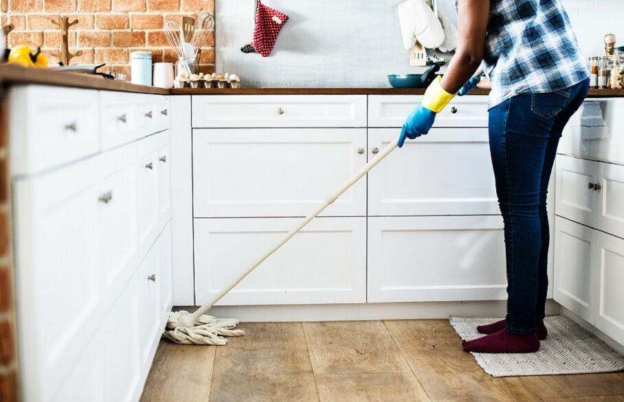 Person cleaning kitchen