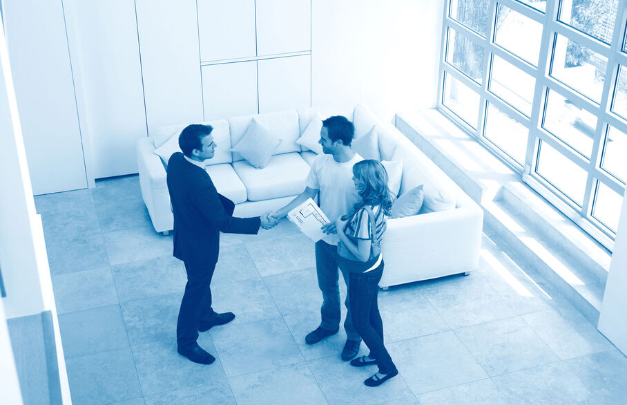 Couple shaking hands with an agent