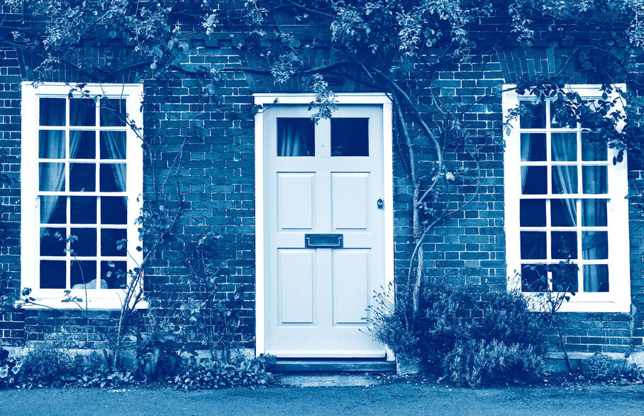 Picture of a door and window to a cottage