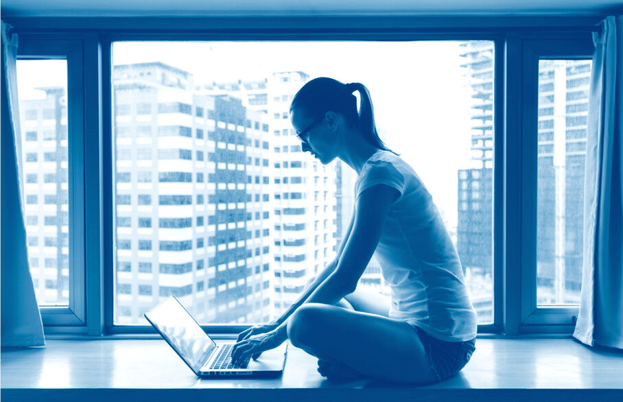 Lady in the window typing on a laptop