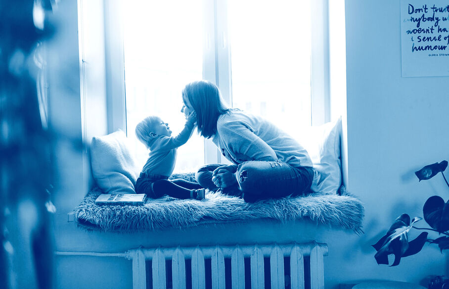 Mother and child sat on a window seat