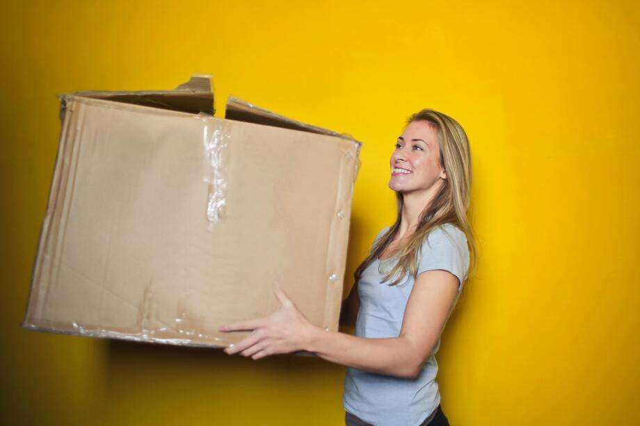 woman moving box