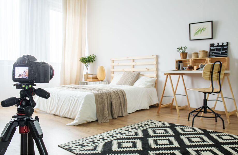 stylish bedroom interior being photographed