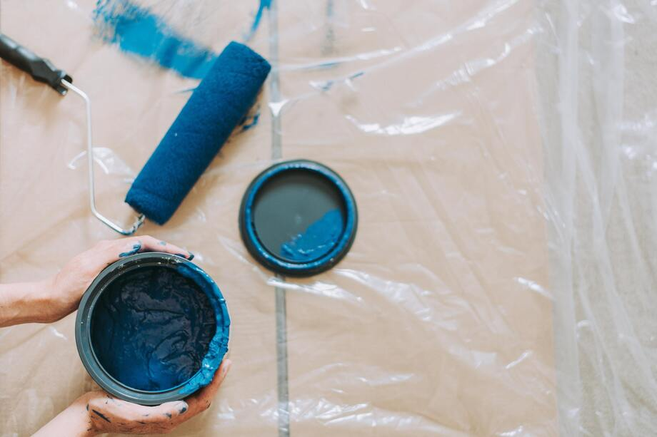 Blue paint and rollers on the floor