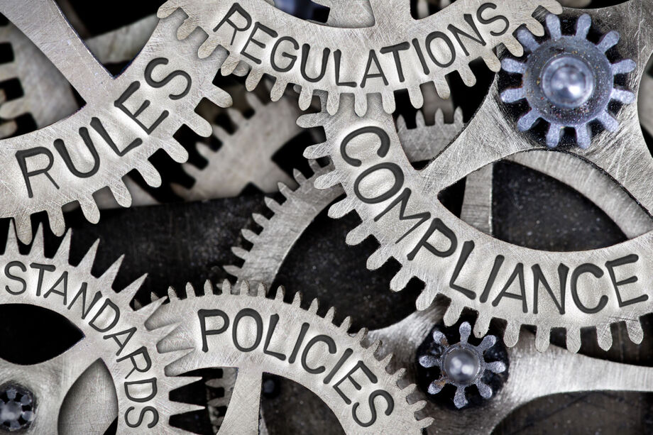 Metal cogs with the wording - compliance, regulations, rules